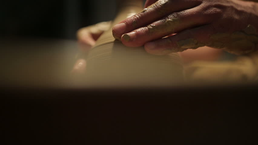 Potter special tools handles clay. Master crock. The creative process in the studio. Twisted potter's wheel. Man creates a work of art. The ability to create beauty. Master kneads the clay.    Shutterstock HD Video #13264115