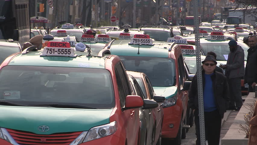 Toronto, Ontario, Canada December 2015 Toronto taxi and cab drivers protest against UBER by blocking traffic