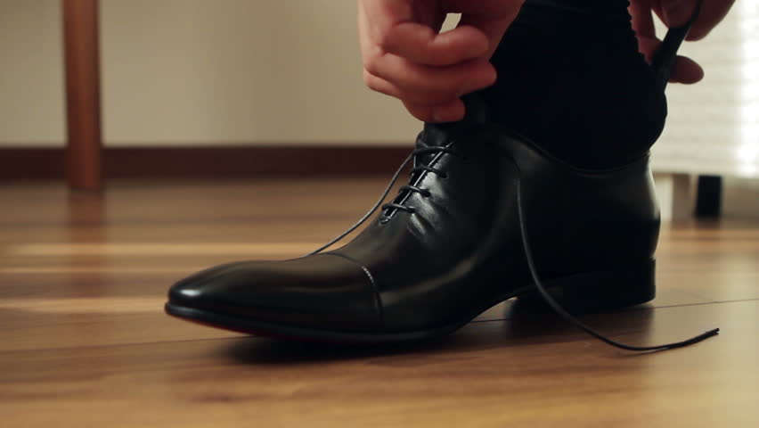 Business man tying the laces on shoes. Businessman dress shoes business. The director is going to work. Businessmen.   Shutterstock HD Video #13292714