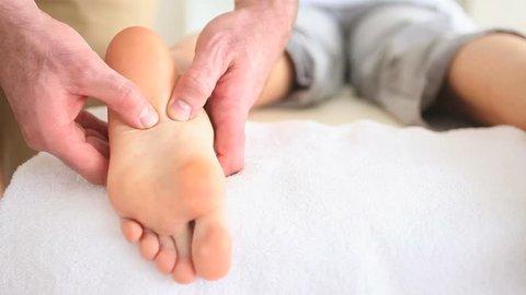 Close up of a reflexology massage in a room