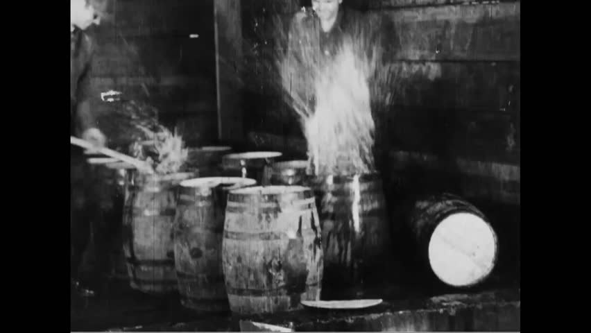 CIRCA 1930s - Federal agents destroy barrels of alcohol during Prohibition.