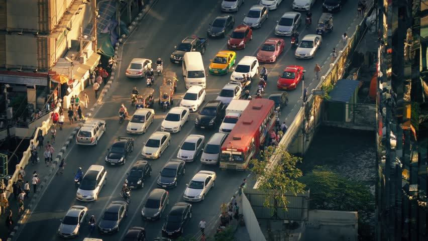 Countless Cars And People Crossing City Bridge In Evening