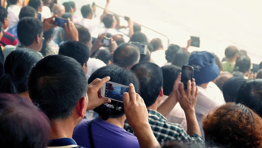 Crowd Of People Filming Event With Smartphones