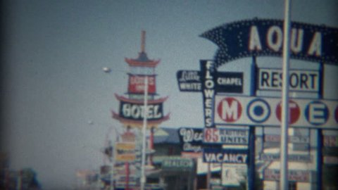 LAS VEGAS 1965: 60's retro business strip motor hotels best western Lotus Inn signs.