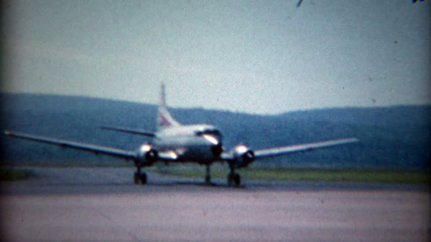 NEW YORK 1965: Convair CV-540 Allegheny Airlines propeller airplane taxis across airport.