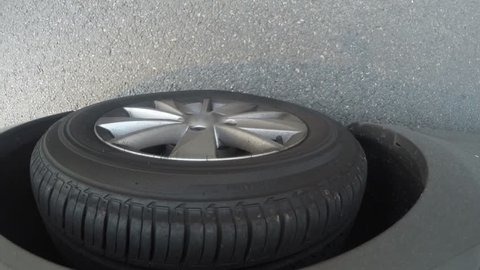 detail of car tyre when car stops and again starts move on the road