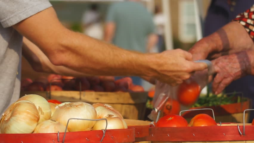 Food being purchased at Farmer's Market