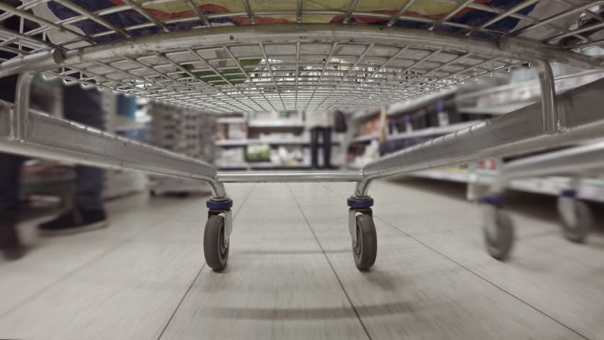 Shopping cart racing through the aisles of hypermarket sped up consumerism | Shutterstock HD Video #13396598