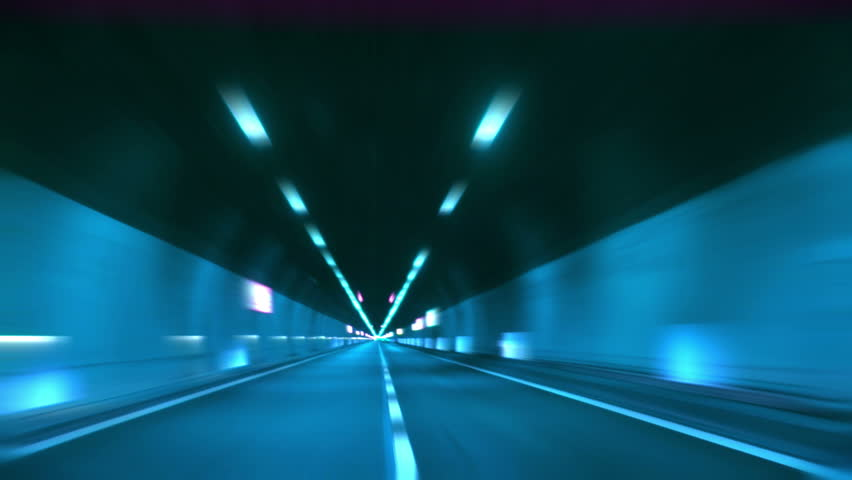 Driving through tunnel, abstract with motion blur and glow. #1341715