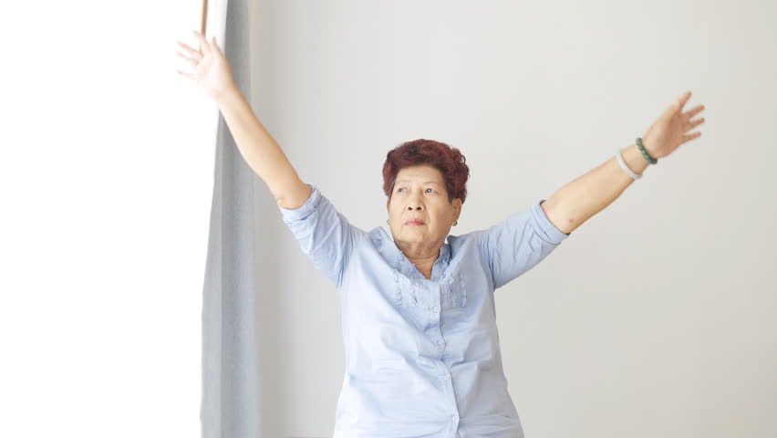 Asian senior woman doing exercise at home. | Shutterstock HD Video #13451105