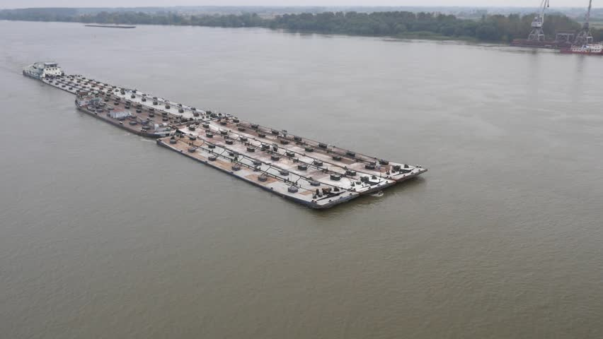 Aerial view on huge tanker ship moving on the river Danube.  | Shutterstock HD Video #13499075