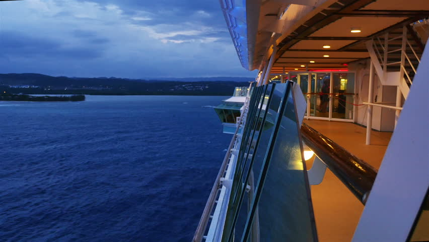 PView Along The Side Of A Cruise Ship As It Departs The - Port side of a cruise ship