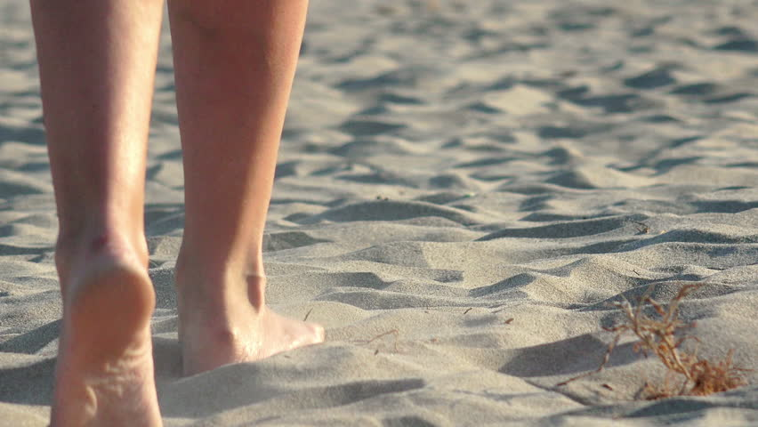 4k Woman walking on sand, footsteps in sand, Back view #13562945