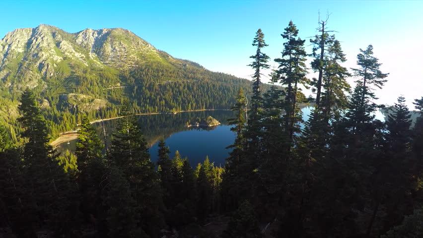 LAKE TAHOE, NEVADA - CIRCA 2015 - A beautiful aerial shot at dawn over Emerald Bay Lake Tahoe. | Shutterstock HD Video #13596314