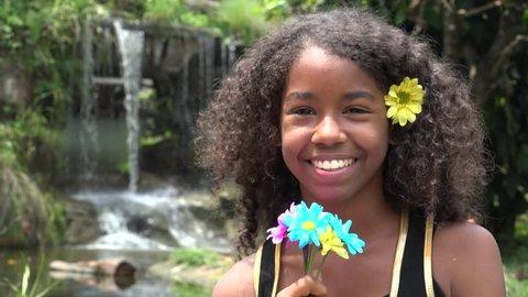 African Teen Girl at Waterfall