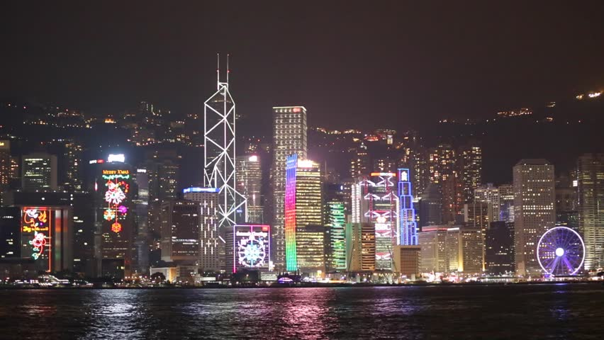 Skyscapers at Victoria's harbor and floating ship, Hong Kong   Shutterstock HD Video #13642445
