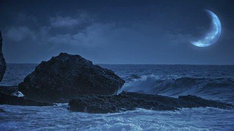 Fantasy sea view with waves crashing at rocks. View at the dark ocean with shiny moon above.