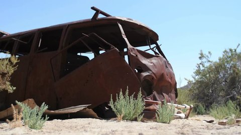 GREEN RIVER, UT - AUGUST 29, 2015: A rust covered VW van lies abandoned on the banks of the Green River in Southeastern Utah.