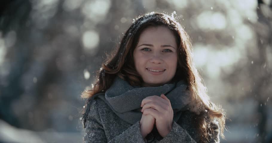 Sunny winter joyful happy woman portrait outdoors on a Sunny winter day | Shutterstock HD Video #13720265
