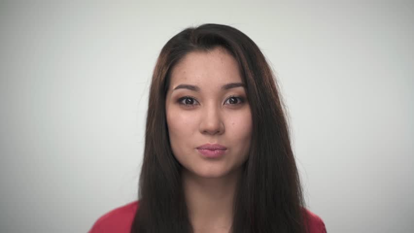 Portrait of pretty young Asian woman smiling at the camera.  Closeup portrait.  | Shutterstock HD Video #13725875
