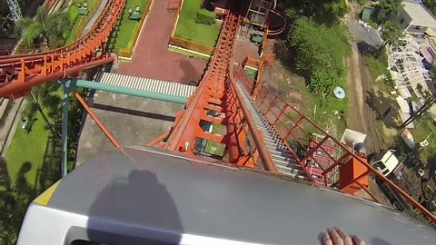 Riding a crazy roller coaster at the front seat point of view footage.
