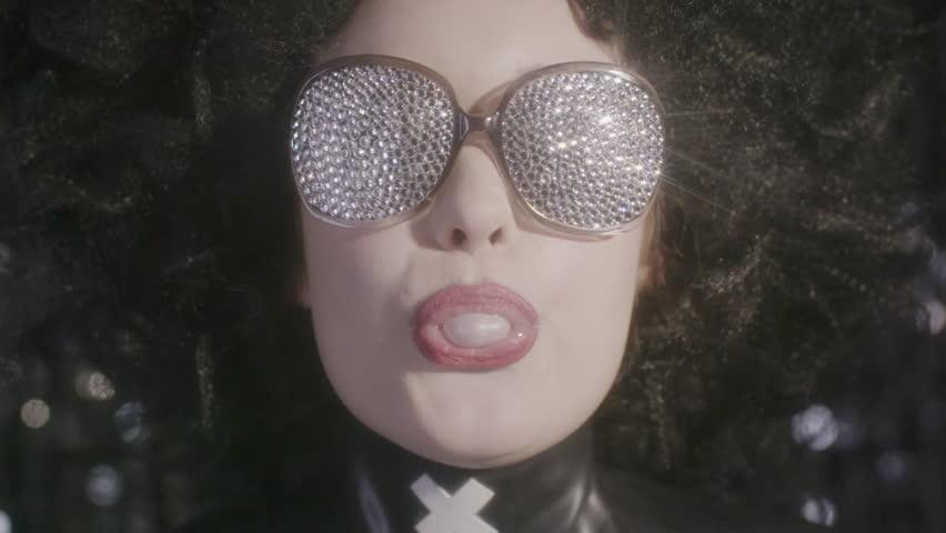 sexy cute gothic model blows bubblegum in slow motion