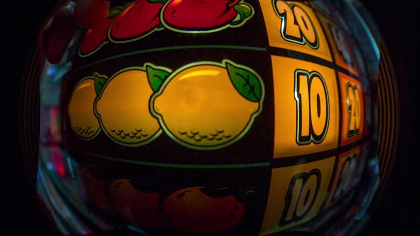 Close up of a gambling fruit machine | Shutterstock HD Video #13744595