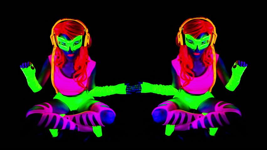 Fantastic video of sexy cyber raver dancer babe filmed in fluorescent clothing under UV black light | Shutterstock HD Video #13746662