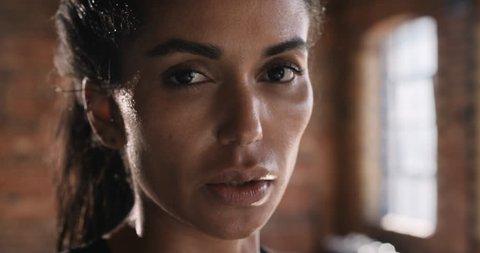 Portrait Beautiful Kickboxing woman training wiping sweat in fitness studio fierce strength fit body slow motion kickboxer