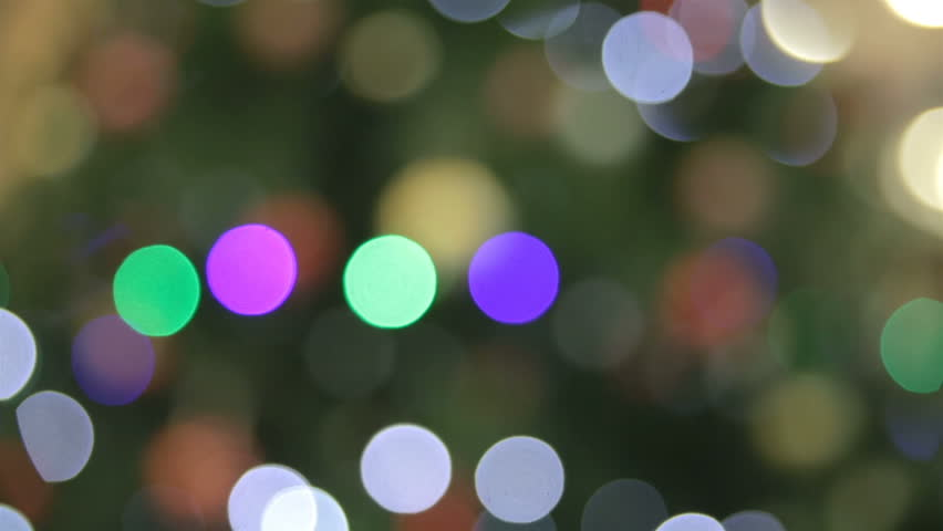 Nice new year bokeh red blue green white lamp on green background | Shutterstock HD Video #13772495