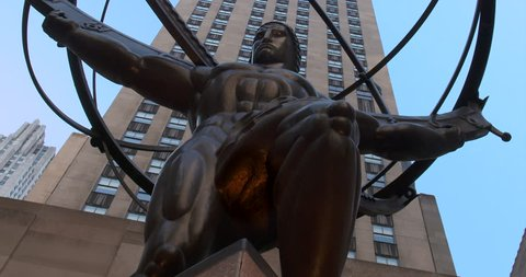 NEW YORK, AUGUST 2015: Iconic Atlas Statue with the Rockefeller Center in the background. Zooming out. (New York, August 2015)