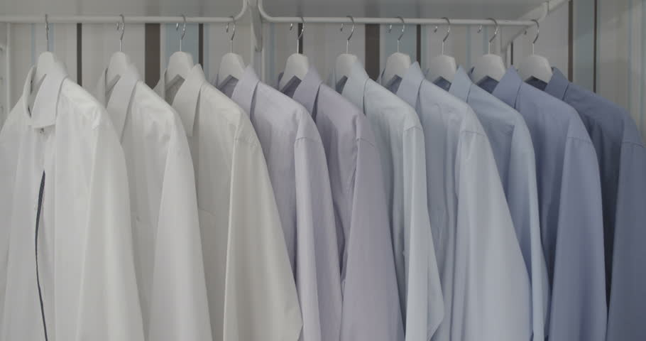 Clean ironed men's shirts set in colors hanging on hangers in the wardrobe flat color | Shutterstock HD Video #13782764
