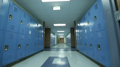 WIDE pan, hallways with two rows of blue lockers on either side