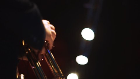 Two men playing on trumpets on the stage 1