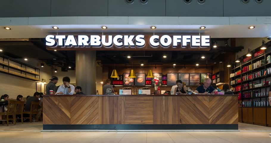 BANGKOK, THAILAND - NOVEMBER 20, 2015: (Time lapse view) Starbucks coffee inside International Airport. Starbucks is the largest coffeehouse company in the world. Time lapse movie.
