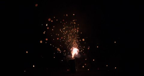 Small firecracker, fuse burns, then explodes.  240fps slow motion.