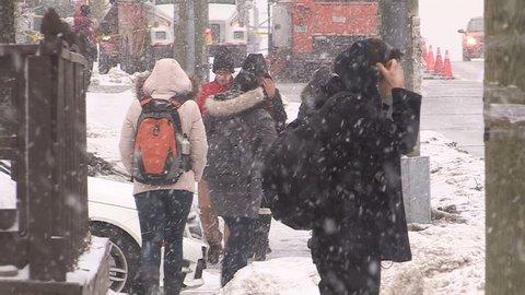 Waterloo, Ontario, Canada January 2014 Pedestrians slip fall on ice sidewalk in winter storm in Waterloo Canada