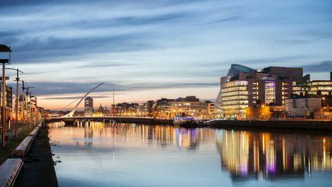 HD time laps video of the City centre and river Liffey with Samuel Beckett Bridge during sunset. Dublin, Ireland