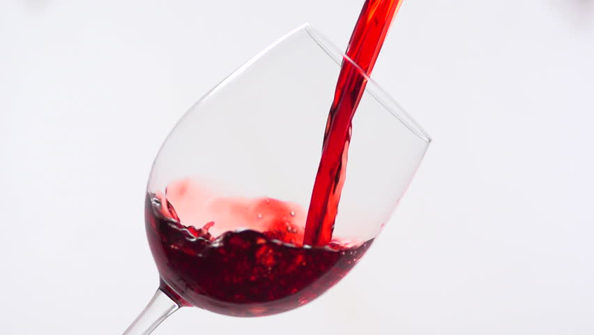Red Wine Pouring into Glass. White Background. Slow Motion Shot 480 fps
