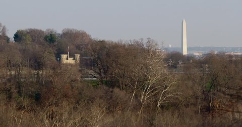 The Washington Monument and The Georgetown Reservoir Castle- Winter 4K view overlooking the Potomac River gorge