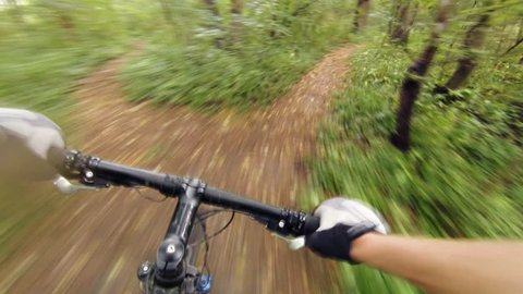 Speed riding downhill a MTB bike on rocky mountain. View from first person perspective POV. Inspiration and motivation extreme sport activity. Gimbal stabilized view.