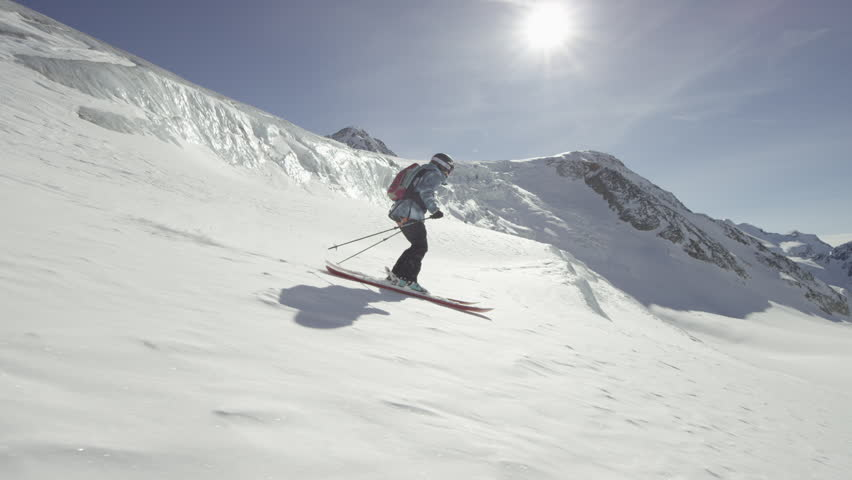 WS TS Woman freestyle skiing on Wildspitze on sunny day / North Tyrol, Austria | Shutterstock HD Video #13971194