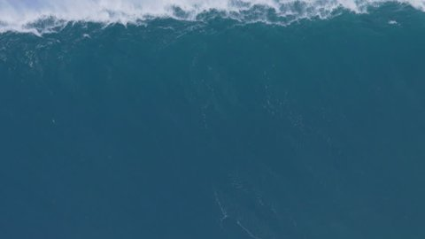 MAUI, HAWAII. January, 15 2016: Surfers Ride Giant Ocean Waves Breaking at Jaws on North Shore in Hawaii. Professional Big Wave Surfing. Biggest Waves Ever Paddled