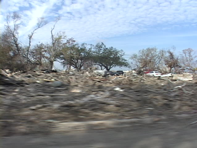 Cars and debris strewn all over show the destruction caused by Hurricane Katrina.