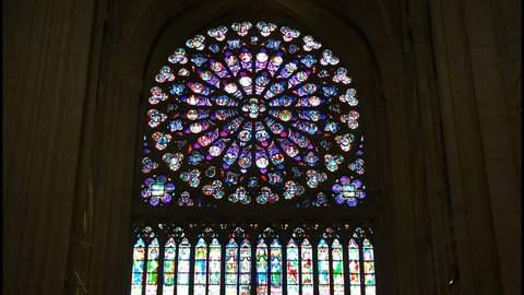 NOTRE DAME, PARIS, FRANCE- SEPTEMBER 20, 2015: a zoom in shot of a stained glass window in notre dame cathedral, paris