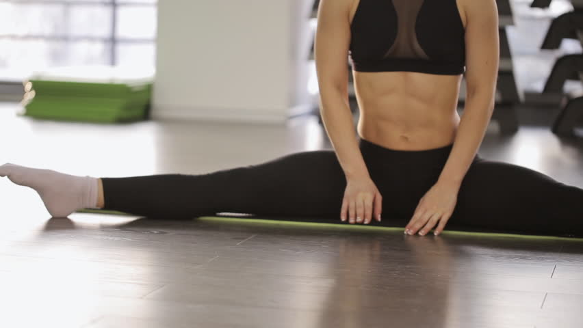 A Woman Athlete Doing Stretching  Stock Footage Video (100% Royalty-free)  14010545 | Shutterstock