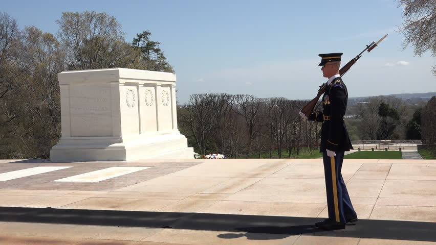WASHINGTON, DC - CIRCA JUN 2015: Arlington National Cemetery Honor Guard Honor Tomb Unknown Soldier 4K. Soldiers from 3rd Infantry Regiment, The Old Guard. Over 400,000 graves. 7,000 funerals a year.