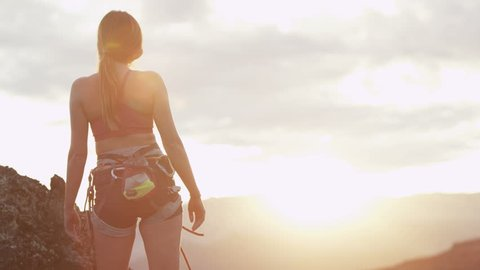 girl takes in the view at the top of a climb