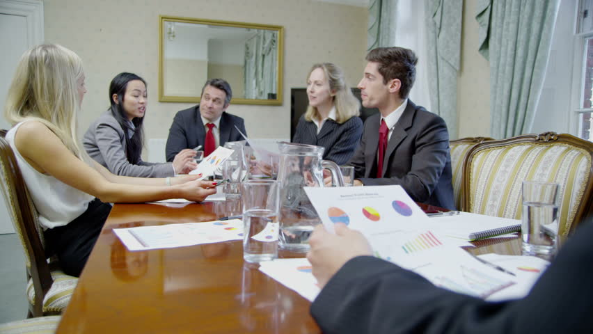 4k / Ultra HD version Successful professionals are seated around a conference table for a business meeting. They are looking at printed diagrams and discussing their business strategy. Shot RED Epic | Shutterstock HD Video #14049272