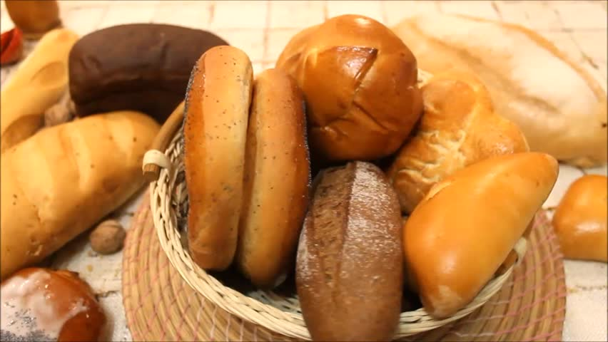Bread in the rotating basket on a table   Shutterstock HD Video #14088335